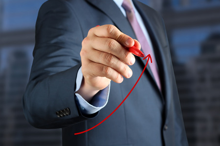 Businesswoman  drawing a virtual  graph by  a red pen photo