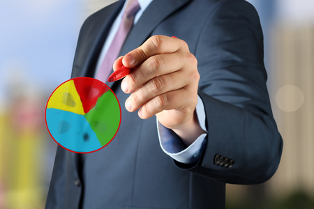 Businesswoman  drawing a virtua multi-colored l diagram  by  a red pen photo