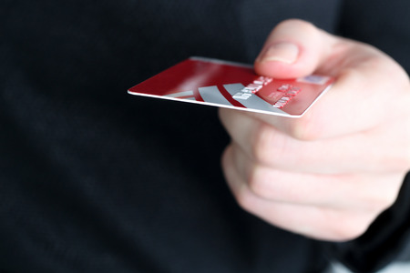 Closeup  image of credit card in human hand in the shop photo
