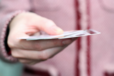 debet: Closeup  image of credit cards in human hand in the shop Stock Photo