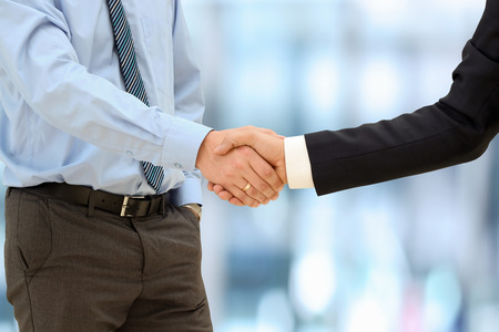 Close-up image of a firm handshake  between two colleagues outside 版權商用圖片