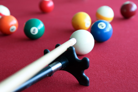 snooker hall: billiard balls in a pool red  table.