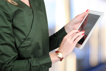 busineswoman: Busineswoman holding  and working with a digital tablet.