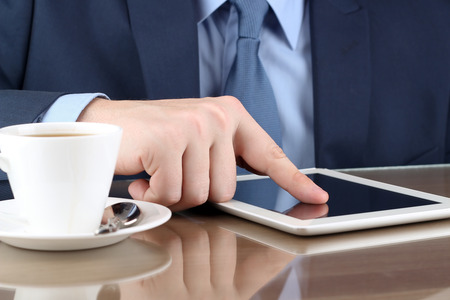 busineswoman: Busineswoman  working with a digital table in the office