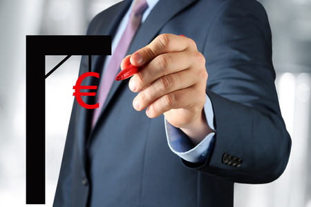 price uncertainty: Businesswoman  drawing a virtual gibbet  with euro by  a red pen Stock Photo