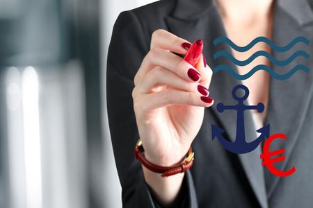 price uncertainty: The Businesswoman  drawing  a sign of sinking euro hanging on  an  anchor Stock Photo