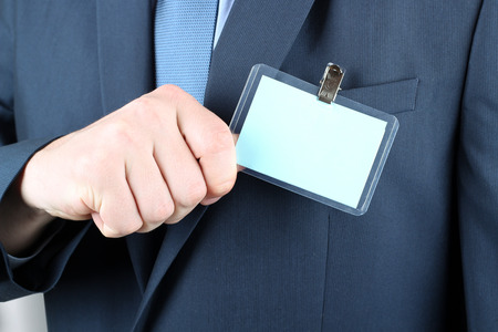name badge: The business man showing a  Blank Badge