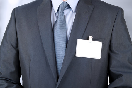 blank tag: The business man in a modern suit with  a  Blank Badge Stock Photo