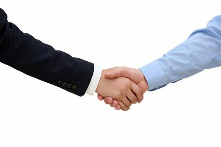 handshake: Primer plano imagen de un firme apret�n de manos entre dos colegas sobre un fondo blanco Foto de archivo
