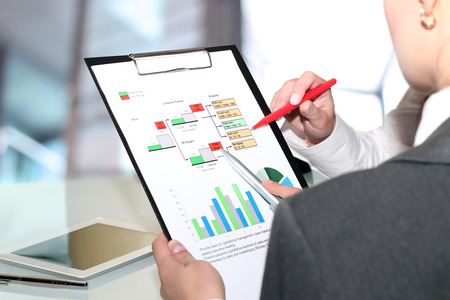 financial figures: Business colleagues working and analyzing financial figures on a graphs Stock Photo