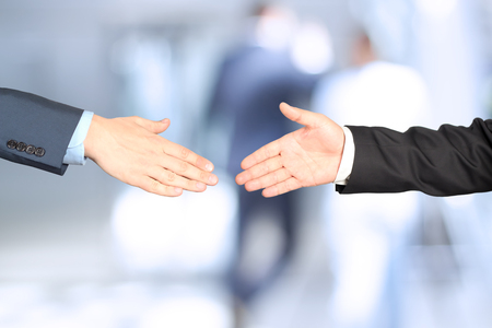 Close-up image of a firm handshake  between two colleagues Standard-Bild