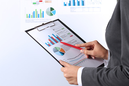 The young businesswoman showing graphs by pen Stock Photo
