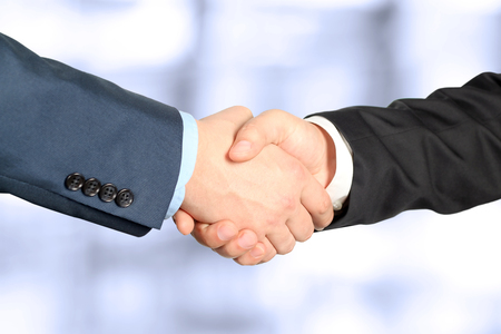 communication concept: Close-up image of a firm handshake  between two colleagues Stock Photo