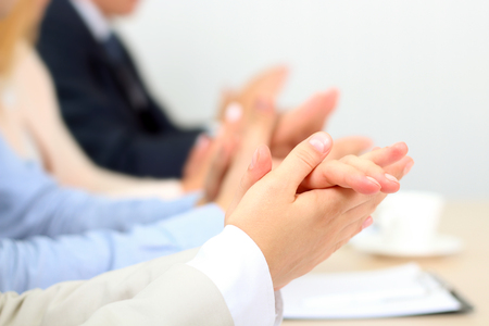 clapping: Close-up of business people clapping hands. Business seminar concept