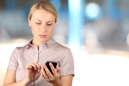 mobile phone screen: Businesswoman holding  and using the  mobile  smart  phone Stock Photo