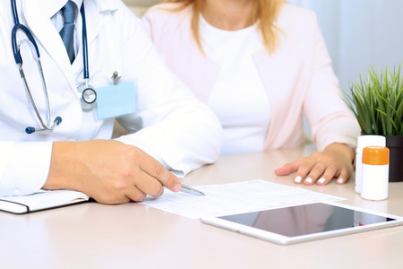 career counseling: doctor explaining diagnosis to female patient Stock Photo