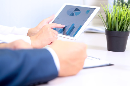 tablet devices: Business people meeting to discuss the situation on the market Stock Photo