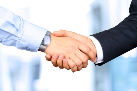 trust: Close-up image of a firm handshake between two colleagues Stock Photo