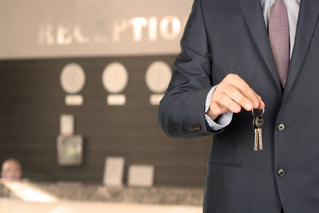 key cabinet: Business man at the reception giving keys Stock Photo