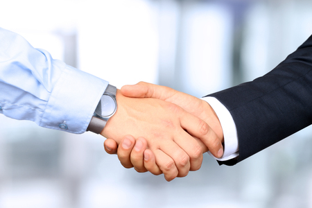 customer: Close-up image of a firm handshake between two colleagues Stock Photo