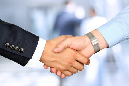 business hand shake: Close-up image of a firm handshake  between two colleagues Stock Photo