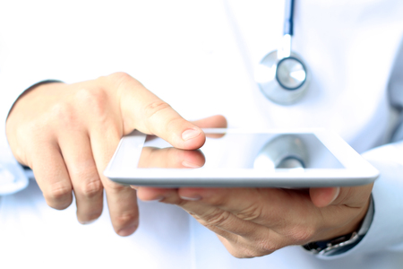 problem health: Doctor working with tablet computer. Stock Photo