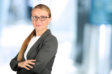 young worker: The Beautiful smiling business woman  portrait.