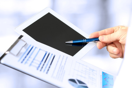 Close-up Of Businessman Analyzing Graph On Digital Tablet Stock Photo