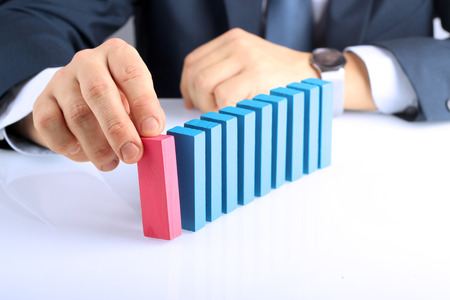 wood blocks: Planning, risk and strategy in business, businessman  pushing  wooden block Stock Photo