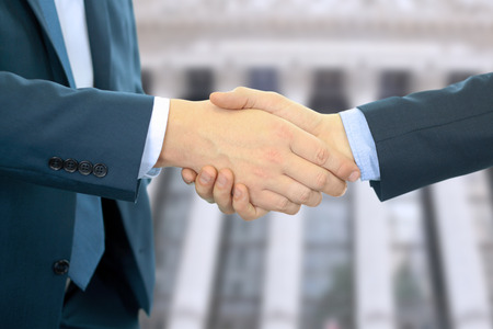 shake hands: Close-up image of a firm handshake between two colleagues in office