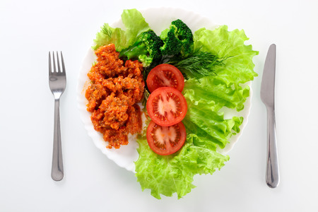 broccolli: Fresh salad with lettuce, broccolli,  tomato and meat on dish Stock Photo