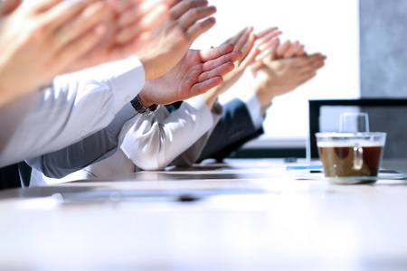 approbation: Close-up of business people clapping hands. Business seminar concept