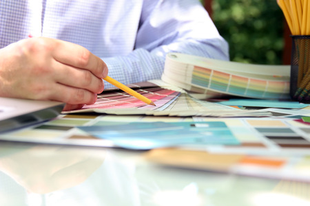 sales agent: sales agent  choosing color samples for design project. Stock Photo