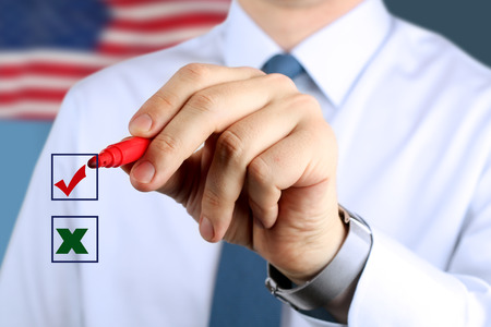 Businessman  making vote  by  a red  pen