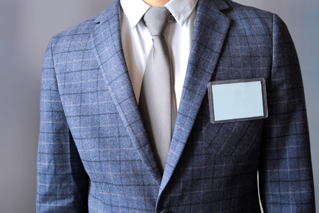The business man standing with a Blank Badge