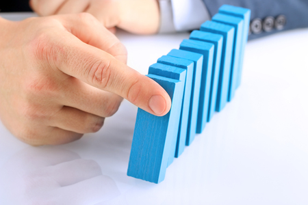 Planning, risk and strategy in business, businessman  pushing  wooden block Stock Photo