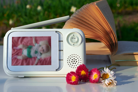 security monitor: The close-up baby monitor for security of the baby
