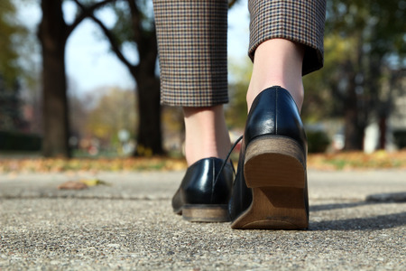 going in: elegant woman in fashion trousers going in a classic fashion boots