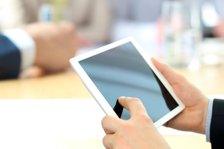 Close-up Of Businessman Analyzing data On Digital Tablet