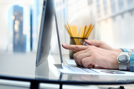business man entering data of a credit card . On-line shopping on the internet using a laptop Stock Photo