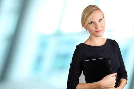 Beautiful smiling business woman portrait. Business people working in the office Standard-Bild - 112592093