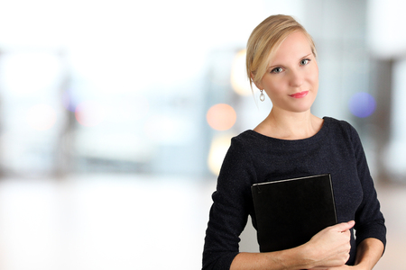 Beautiful smiling business woman portrait. Business people working in the office