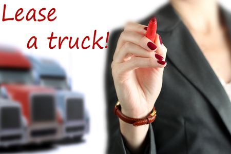Businesswoman leasing a new truck to driver  company Stock Photo