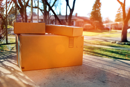 Parcels (boxes)  Delivery Outside the  Door Imagens