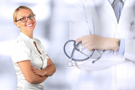 Beautiful smiling woman. Medicine. Doctor standing with stethoscope 版權商用圖片