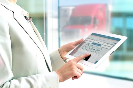 Safety manager shows logbook on a tablet