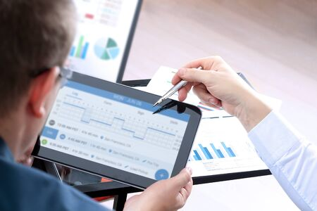 Safety manager shows logbook on a tablet Standard-Bild