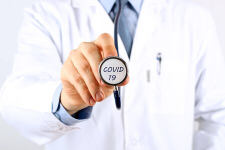 Doctor holding stethoscope  with  covid 19
