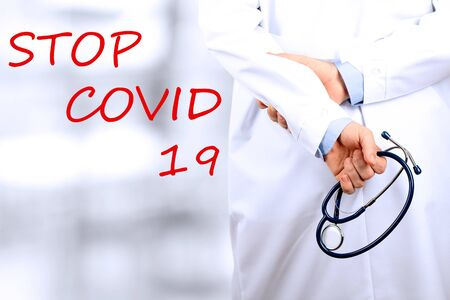 Stop Covid - 19. Doctor is standing with  a stethoscope Standard-Bild