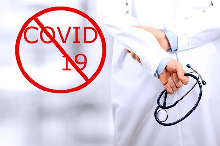 Stop Covid - 19. Doctor is standing with  a stethoscope Standard-Bild - 149826812